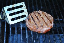 Flipping Hamburger On Grill Royalty Free Stock Photography