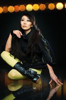 Sitting Brunette Asian Model Stock Photography