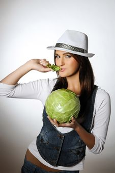 Young Pretty Woman With Green Cabbage Stock Photography