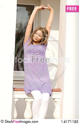 Free Girl Sitting On Veranda Royalty Free Stock Photo - 14171185