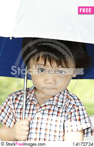 Free Cute Asian Boy With Umbrella Stock Images - 14172734