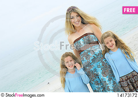 Free Mother And Twin Daughters At The Beach Stock Photography - 14173172