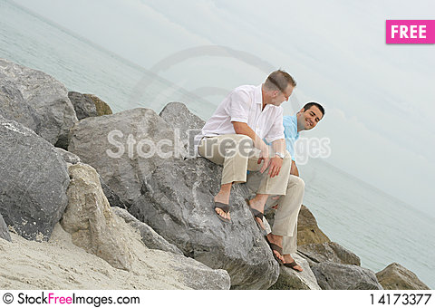 Free Attractive Male Models On Rocks Royalty Free Stock Photography - 14173377