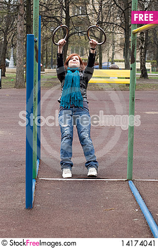 Free Sportive Girl Hanging On The Rings Stock Image - 14174041