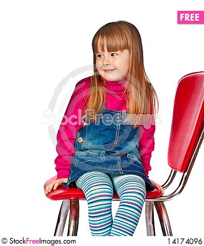 Free Portrait Of Beautiful Little Girl Sitting On Chair Royalty Free Stock Image - 14174096