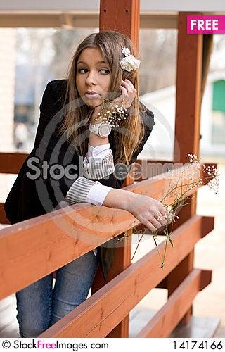 Free Girl Standing On A Veranda Royalty Free Stock Image - 14174166
