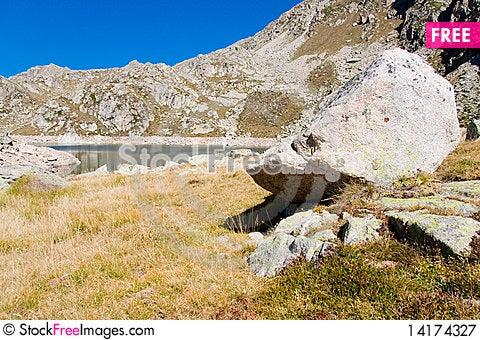 Free Big Stone And Lake Royalty Free Stock Photography - 14174327