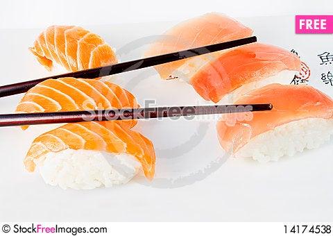Free Salmon And Tuna Sushi With Chopsticks Royalty Free Stock Photos - 14174538