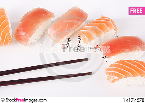 Free Salmon And Tuna Sushi With Chopsticks Royalty Free Stock Photos - 14174578