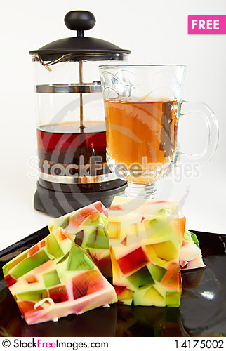Free Fruit Jelly With Teapot And Cup Of Tea Stock Photography - 14175002