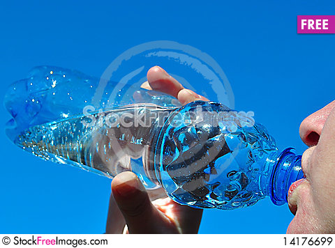 Free Water. Girl Drinks From The Bottle Royalty Free Stock Images - 14176699