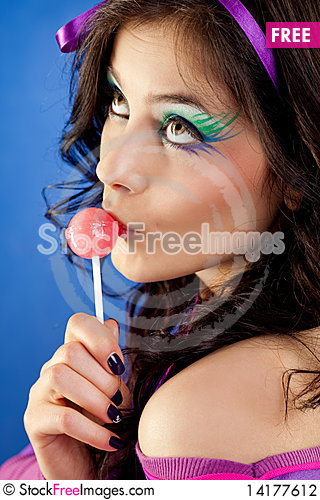 Free Girl Licking Lollipop Stock Photography - 14177612