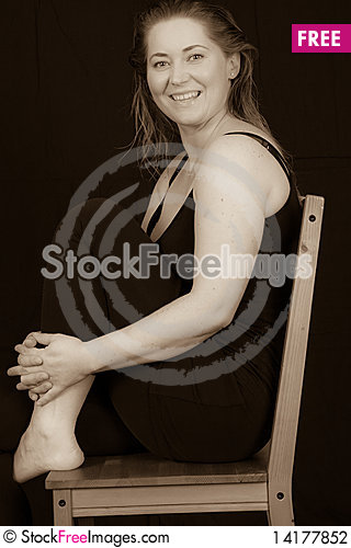 Free Woman Sitting On A Chair Stock Photography - 14177852