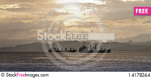 Free Haulage Cargo Boats And Sunset Stock Images - 14178264