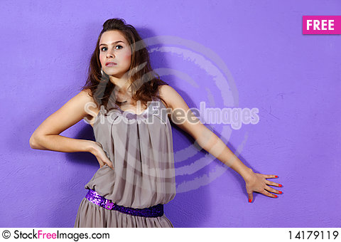 Free Beautiful Woman Wearing Beige Dress And Lilac Glit Royalty Free Stock Images - 14179119