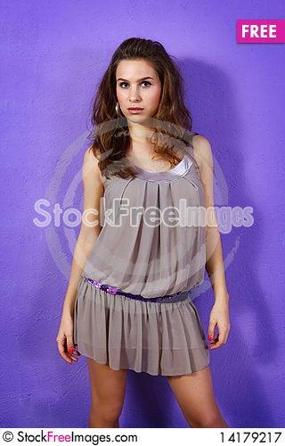 Free Beautiful Woman Wearing Beige Dress And Lilac Glit Royalty Free Stock Photography - 14179217