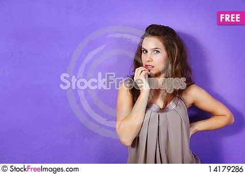 Free Beautiful Woman Wearing Beige Dress And Lilac Glit Royalty Free Stock Image - 14179286