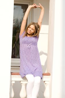 Girl Sitting On Veranda Royalty Free Stock Photo