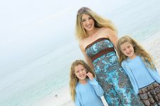 Mother And Twin Daughters At The Beach Stock Photography