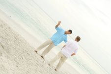 Free Male Models Talking On The Beach Stock Photography - 14173392