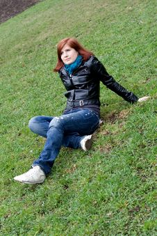Free Girl Sitting On Grass Royalty Free Stock Photo - 14173825