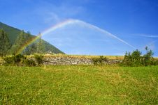 Free Watering A Garden In Mountain And Rainbow Royalty Free Stock Image - 14174106