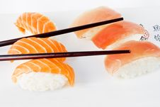 Free Salmon And Tuna Sushi With Chopsticks Royalty Free Stock Photos - 14174538