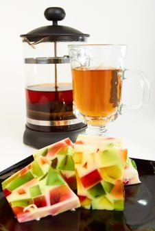 Fruit Jelly With Teapot And Cup Of Tea Stock Photography