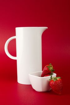 White Jug On Red Background Stock Image