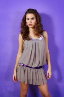 Beautiful Woman Wearing Beige Dress And Lilac Glit Royalty Free Stock Photography