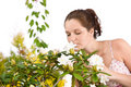 Free Portrait Of Woman Smelling Blossom Of Rhododendron Royalty Free Stock Photo - 14182565