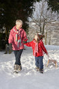 Free Young Girl With Grandmother Pulling Sledge Royalty Free Stock Photos - 14189028