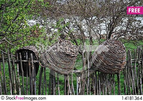 Free Wicker Baskets On Wicker Fence Stock Images - 14181364