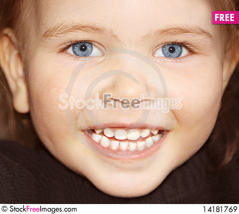 Free Llittle Girl Happily Smiling Royalty Free Stock Images - 14181769