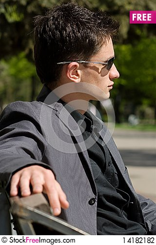 Free Man In Sunglasses Sitting On A Bench Stock Photography - 14182182