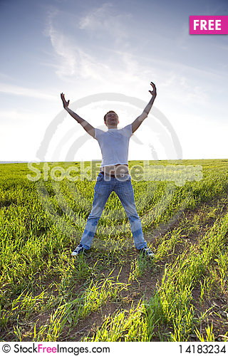 Free Man Stay In Green Field With Hands Up Stock Images - 14183234