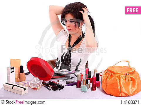 Free Beautiful Young Woman Arranges Her Hair Stock Image - 14183871