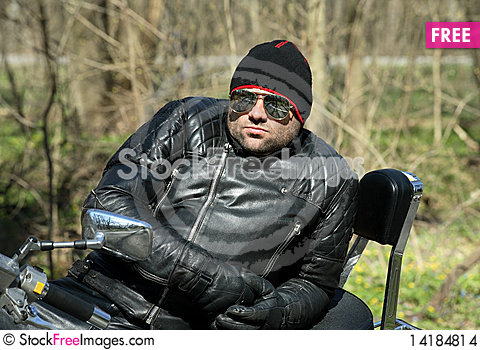Free Biker Sitting On His Motorcycle Stock Images - 14184814