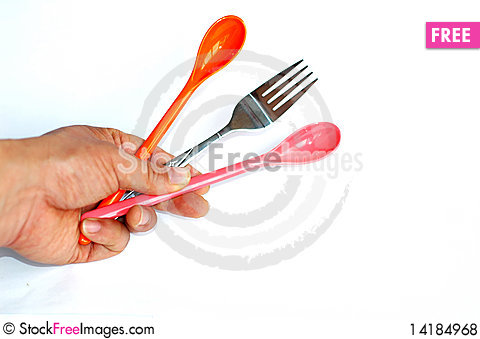 Free Spoons And Fork In Hand Royalty Free Stock Photos - 14184968