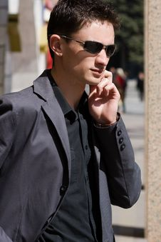 Free Businessman In Sunglasses Talks On Mobile Phone Stock Photos - 14182163