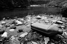 Plastic Container On The River Stock Photography