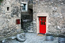 Small Stone Village With Coloured Doors, Italy Stock Image