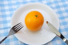 Orange With Fork And Knife Stock Photography