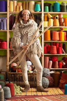 Free Woman Wearing Knitted Scarf Holding Giant Needles Royalty Free Stock Images - 14188539