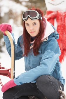 Free Teenage Girl With Sledge Next To Snowman Royalty Free Stock Images - 14188729