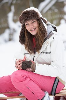 Free Girl Sitting On Sledge With Hot Drink Royalty Free Stock Photo - 14188765