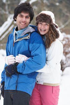 Romantic Teenage Couple In Snow Royalty Free Stock Image