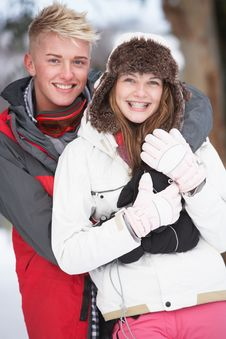 Romantic Teenage Couple In Snow Royalty Free Stock Photography