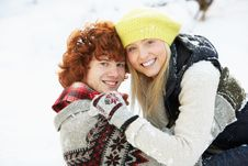 Teenage Couple Having Fun In Snow Stock Photos