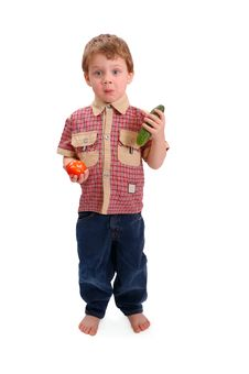 The Little Boy With Vegetables Royalty Free Stock Image